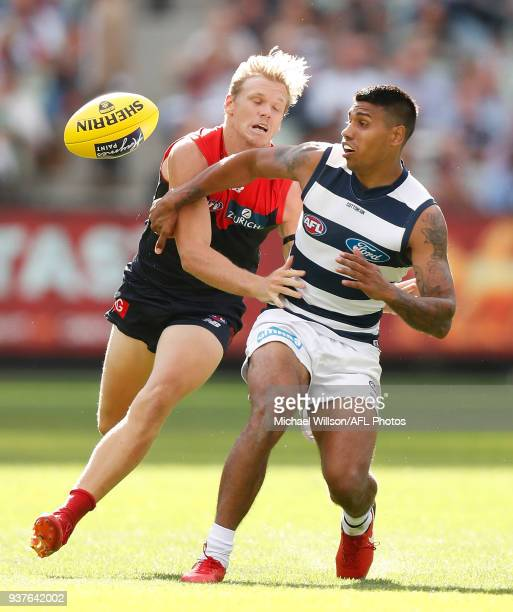 Tim Kelly of the Cats and Josh Wagner of the Demons compete for the ball during the 2018 AFL round 01 match between the Melbourne Demons and the...