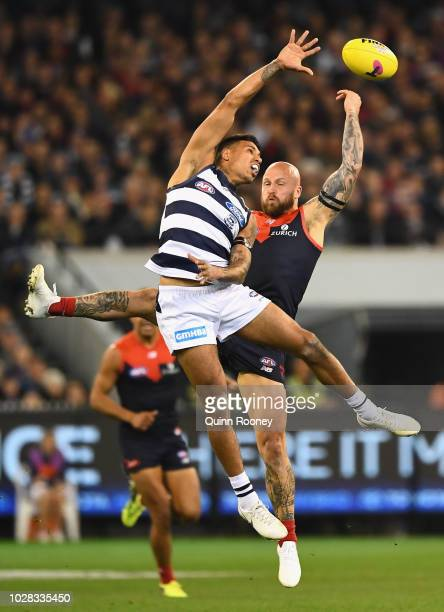 Tim Kelly of the Cats and Nathan Jones of the Demons compete for a mark during the AFL First Elimination Final match between the Melbourne Demons and...