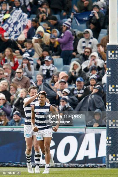 Tim Kelly of the Cats celebrates a goal during the round 22 AFL match between the Geelong Cats and the Fremantle Dockers at GMHBA Stadium on August...