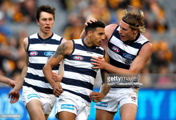 Tim Kelly of the Cats celebrates a goal with Jack Henry and Mark Blicavs of the Cats during the 2018 AFL round 21 match between the Hawthorn Hawks...