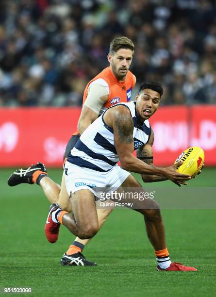 Tim Kelly of the Cats gathers the ball during the round seven AFL match between the Geelong Cats and the Greater Western Sydney Giants at GMHBA...