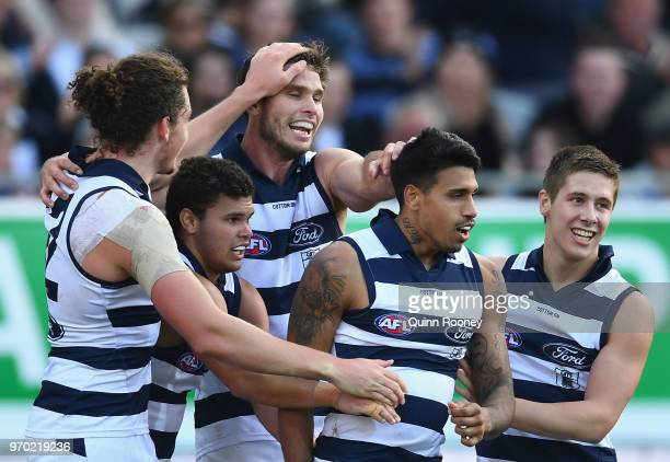 Tim Kelly of the Cats is congratulated by team mates after kicking a goal during the round 12 AFL match between the Geelong Cats and the North...