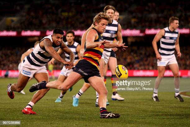 Tim Kelly of the Cats tackles Rory Sloane of the Crows during the 2018 AFL round 17 match between the Adelaide Crows and the Geelong Cats at Adelaide...