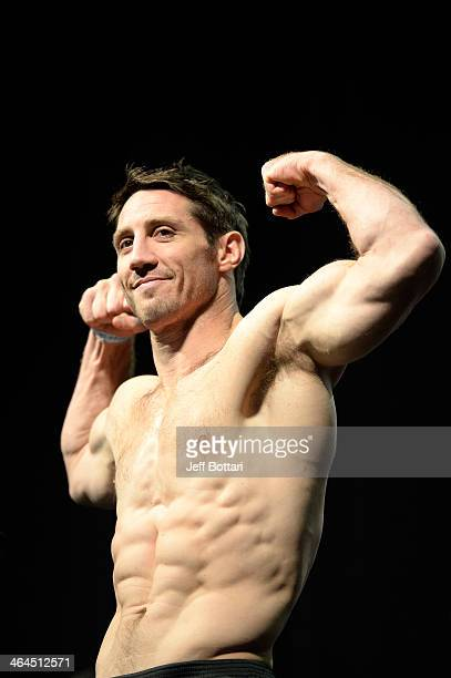 Tim Kennedy steps on the scale during the UFC Fight For the Troops weighin at the Fort Campbell Sabre Air Field hanger on November 5 2013 in Fort...