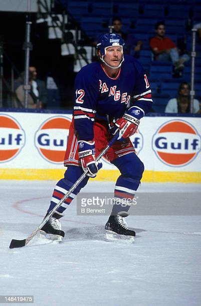 Tim Kerr of the New York Rangers skates on the ice during an NHL game against the New York Islanders in 1992 at the Nassau Coliseum in Uniondale New...