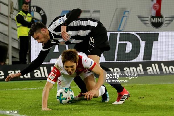 Tim Kister of Sandhausen challenges Genki Haraguchi of Duesseldorf during the Second Bundesliga match between Fortuna Duesseldorf and SV Sandhausen...