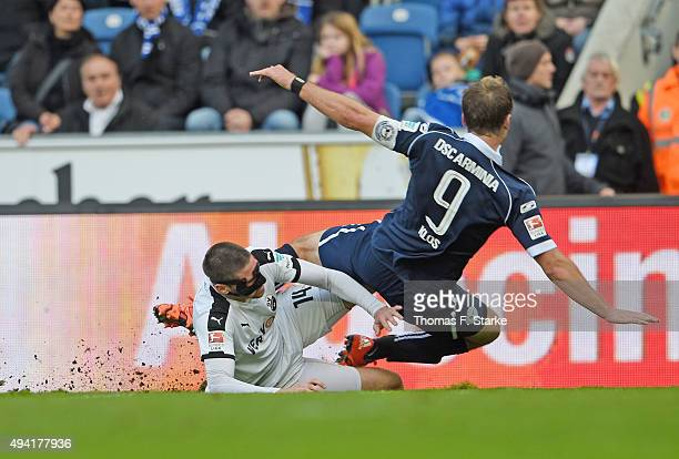 Tim Kister of Sandhausen tackles Fabian Klos of Bielefeld during the Second Bundesliga match between Arminia Bielefeld and SV Sandhausen at Schueco...