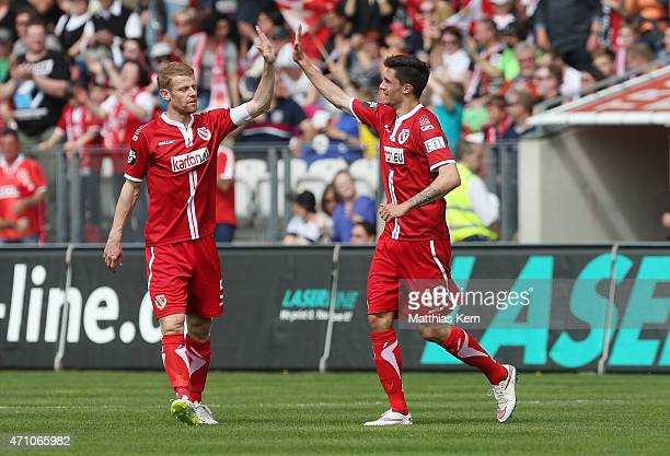 Tim Kleindienst of Cottbus jubilates with team mate Uwe Moehrle after scoring the second goal during the third league match between FC Energie...