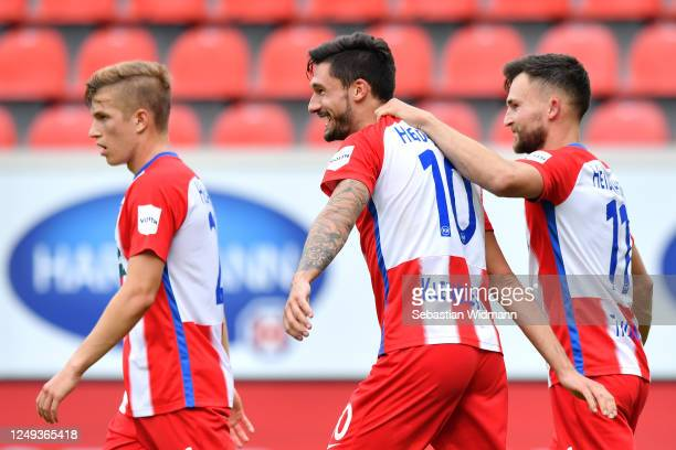 Tim Kleindienst of FC Heidenheim 1846 celebrates scoring his teams second goal of the game with team mates during the Second Bundesliga match between...