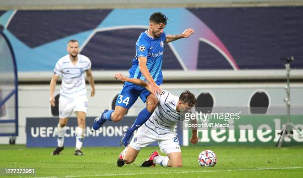 Tim Kleindienst of KAA Gent battles for the ball with Illia Zabarnyi of Kyiv during the UEFA Champions League PlayOff first leg match between KAA...