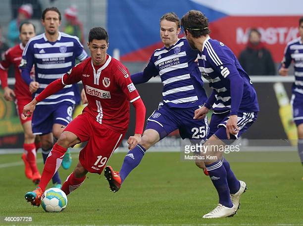 Tim Kleindienst of Osnabrueck battles for the ball with Christian Gross of Cottbus during the third league match between FC Energie Cottbus and VFL...
