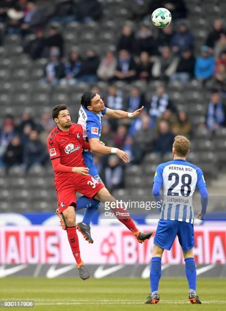 Tim Kleindienst of SC Freiburg and Karim Rekik and Fabian Lustenberger of Hertha BSC during the Bundesliga match between Hertha BSC and SC Freiburg...