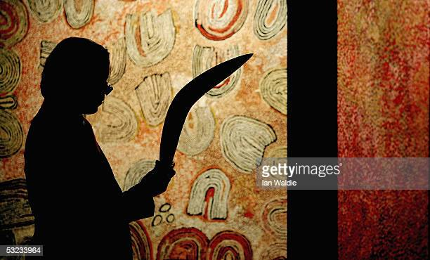 Tim Klingender Director of Aboriginal Art at Sotheby's inspects a boomerang from North Western Australia before a record auction of Aboriginal Art...