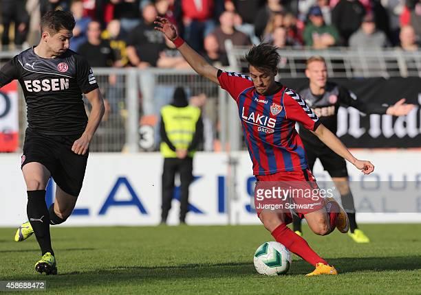 Tim Knetsch of Uerdingen kicks the ball beside Sven Kreyer of Essen during the Regionalliga West match between KFC Uerdingen and RotWeiss Essen on...