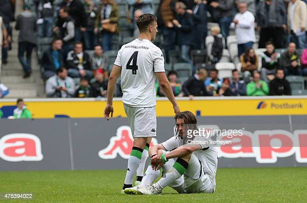 Tim Knipping and Oliver Stang of Borussia Moenchengladbach are dejected after the 3 Liga Playoffs match between Borussia Moenchengladbach II and...