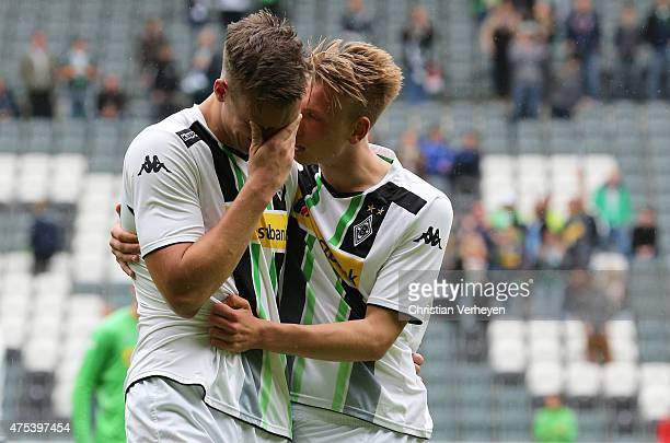 Tim Knipping of Borussia Moenchengladbach is comforted by Nico Brandenburger of Borussia Moenchengladbach after the 3 Liga Playoffs match between...