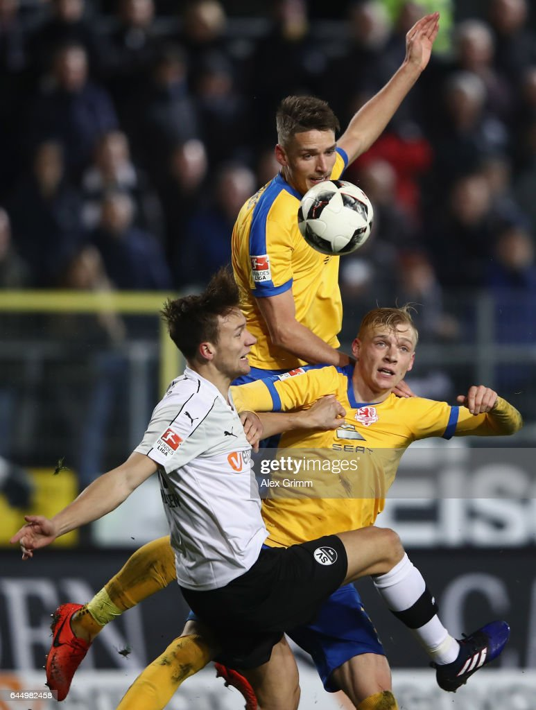 Tim Knipping (L) of Sandhausen jumps for a header with Gustav Valsvik (back) and Saulo Decarli of Braunschweig during the Second Bundesliga match between SV Sandhausen and Eintracht Braunschweig at Hardtwaldstadion on February 24, 2017 in Sandhausen, Germany.