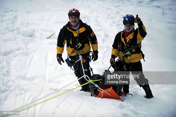 ICETRAINING Tim Krantz right and Cary Sloan left of Colorado Springs fire department succeeded to rescure Jon Messersmith center from the ice wall of...