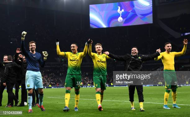 Tim Krul Adam Idah Tom Trybull and Josip Drmic of Norwich City celebrate with teammates after winning the penalty shootout in the FA Cup Fifth Round...