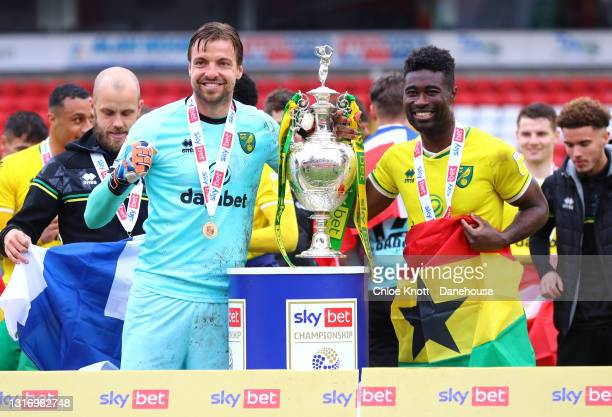 Tim Krul and Alexander Tettey of Norwich City pose with the Sky Bet Championship trophy during the Sky Bet Championship match between Barnsley and...