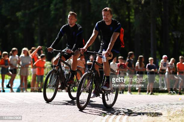 Tim Krul and Luuk de Jong of Netherlands arrive on a bike prior to the Netherlands Training Session ahead of the UEFA Euro 2020 Group C match between...