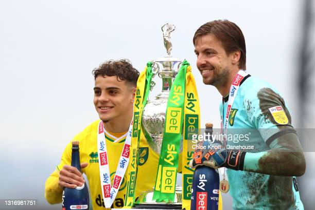 Tim Krul and Max Aarons of Norwich City pose with the Sky Bet Championship trophy during the Sky Bet Championship match between Barnsley and Norwich...