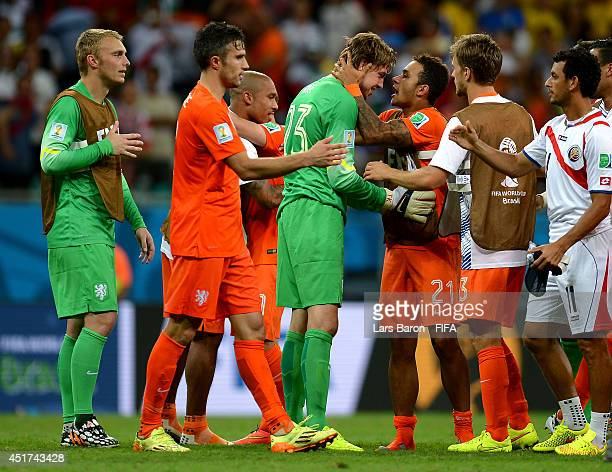 Tim Krul and the Netherlands players celebrate the win after the penalty shootout in the 2014 FIFA World Cup Brazil Quarter Final match between...
