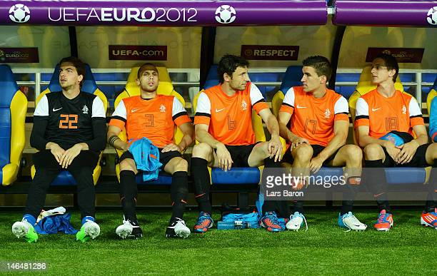 Tim Krul John Heitinga Mark van Bommel Kevin Strootman and Luuk de Jong of Netherlands sit on the bench during the UEFA EURO 2012 group B match...