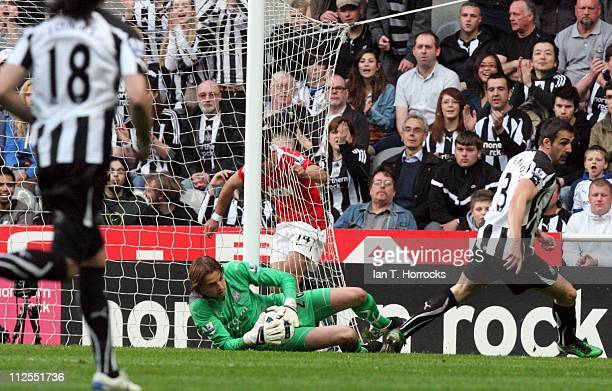 Tim Krul of Newcastle United makes a save against Javier Hernadez during the Barclays Premier League match between Newcastle United and Manchester...
