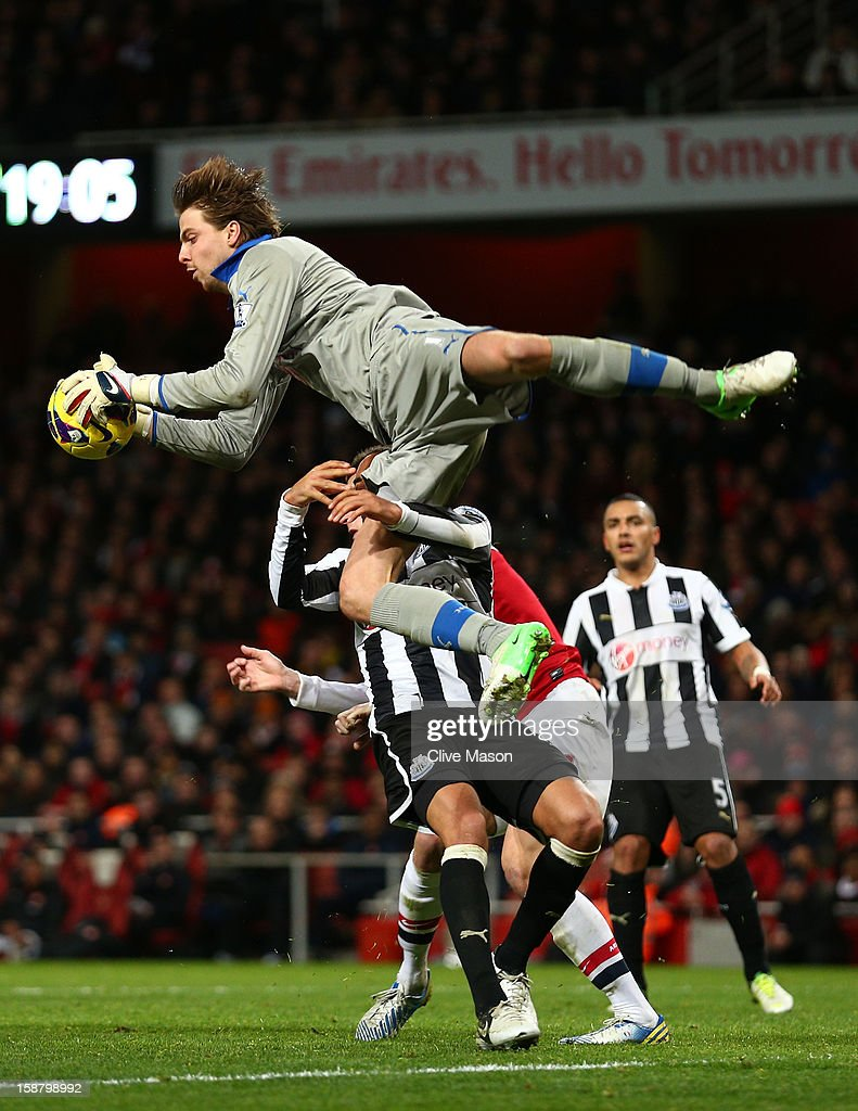 Tim Krul of Newcastle United makes a save during the Barclays Premier League match between Arsenal and Newcastle United at the Emirates Stadium on December 29, 2012 in London, England.