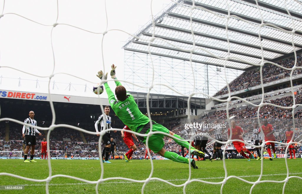 Tim Krul of Newcastle United makes a save from a Luis Suarez of Liverpool freekick in stoppage time during the Barclays Premier League match between Newcastle United and Liverpool at St James' Park on October 19, 2013 in Newcastle upon Tyne, England.