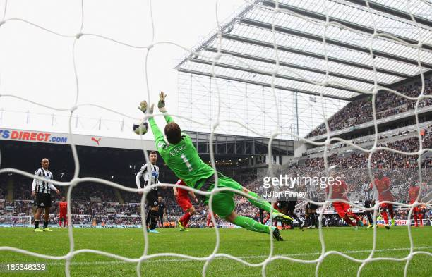 Tim Krul of Newcastle United makes a save from a Luis Suarez of Liverpool freekick in stoppage time during the Barclays Premier League match between...