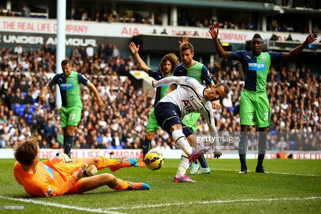Tim Krul of Newcastle United saves a backheel from Roberto Soldado of Spurs during the Barclays Premier League match between Tottenham Hotspur and Newcastle United at White Hart Lane on October 26, 2014 in London, England.