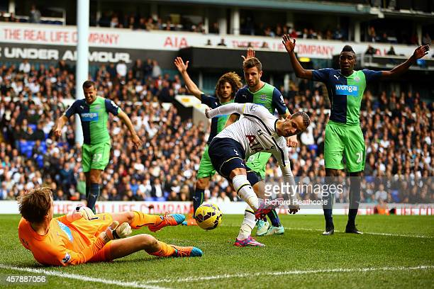 Tim Krul of Newcastle United saves a backheel from Roberto Soldado of Spurs during the Barclays Premier League match between Tottenham Hotspur and...