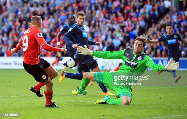 Tim Krul of Newcastle United stops a shot from Craig Bellamy of Cardiff City during the Barclays Premier League match between Cardiff City and...