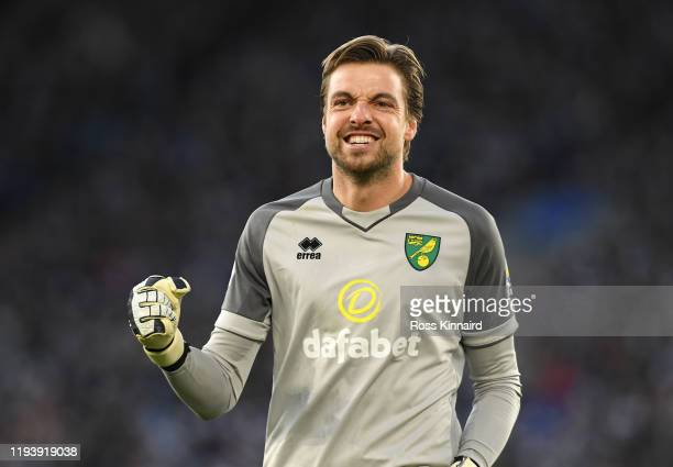 Tim Krul of Norwich City celebrates after his teammate Teemu Pukki of Norwich City scored their team's first goal during the Premier League match...