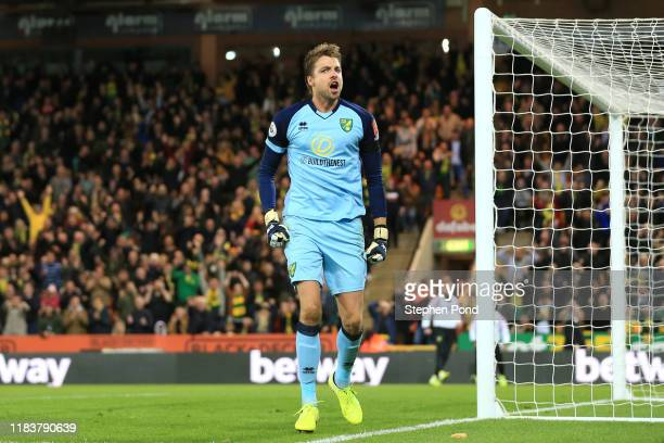 Tim Krul of Norwich City celebrates after saving a penalty from Anthony Martial of Manchester United during the Premier League match between Norwich...