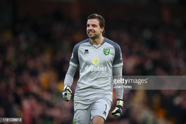 Tim Krul of Norwich City celebrates his sides second goal during the Premier League match between Norwich City and Arsenal FC at Carrow Road on...