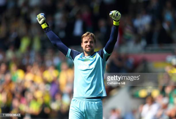 Tim Krul of Norwich City celebrates the goal scored by Todd Cantwell during the Premier League match between Norwich City and Chelsea FC at Carrow...