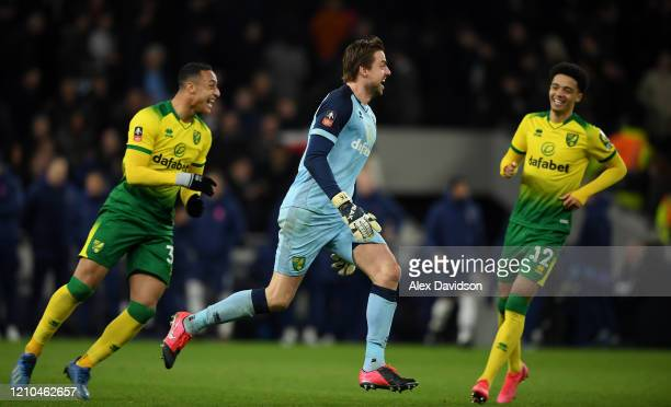 Tim Krul of Norwich City celebrates victory with Adam Idah during the FA Cup Fifth Round match between Tottenham Hotspur and Norwich City at...