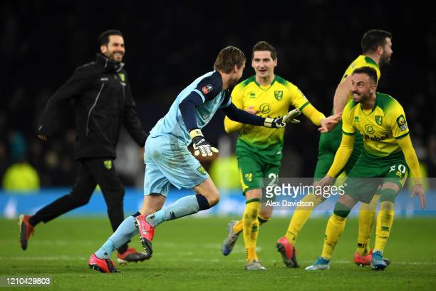 Tim Krul of Norwich City celebrates with Josip Drmic of Norwich City after winning the penalty shootout in the FA Cup Fifth Round match between...