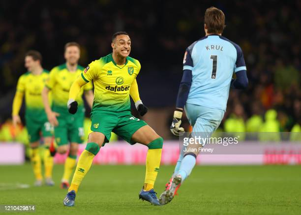 Tim Krul of Norwich City celebrates with teammate Adam Idah following their sides victory in the FA Cup Fifth Round match between Tottenham Hotspur...