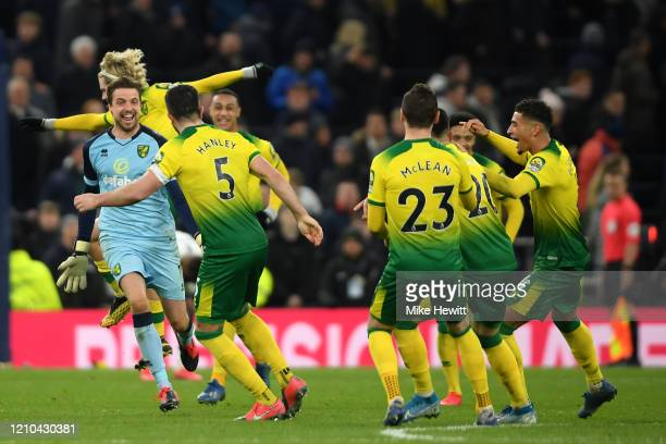 Tim Krul of Norwich City celebrates with teammate Grant Hanley and their teammates after winning the penalty shootout during the FA Cup Fifth Round...