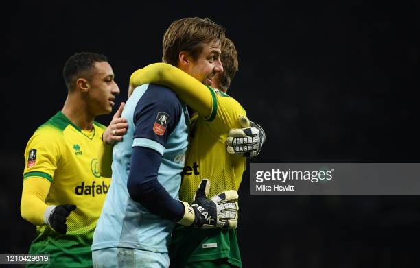 Tim Krul of Norwich City celebrates with teammates after winning the penalty shootout during the FA Cup Fifth Round match between Tottenham Hotspur...