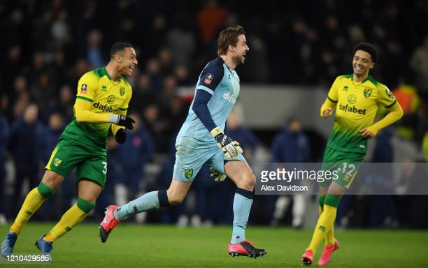 Tim Krul of Norwich City celebrates with teammates Jamal Lewis and Adam Idah of Norwich City following their sides victory in the FA Cup Fifth Round...