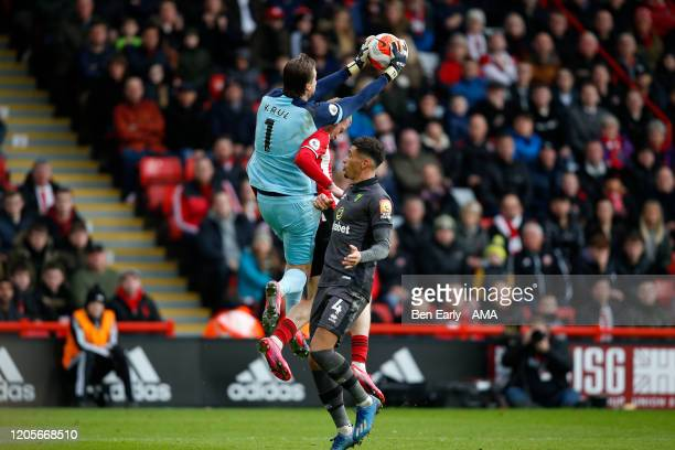 Tim Krul of Norwich City collects the ball mid air away from Old McBurnie of Sheffield United during the Premier League match between Sheffield...
