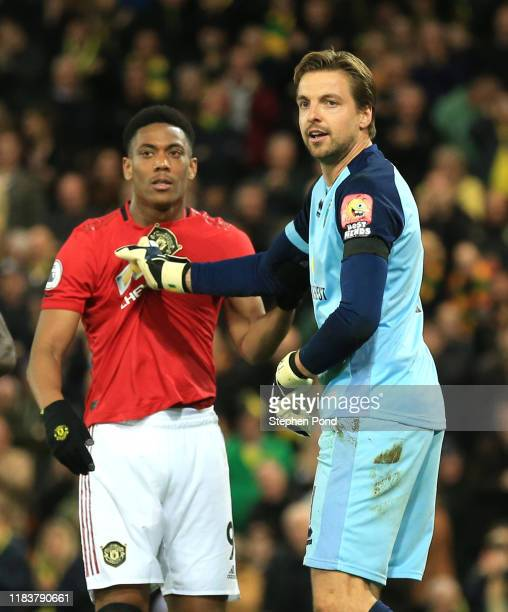 Tim Krul of Norwich City grabbs the shirt of Anthony Martial of Manchester United during the Premier League match between Norwich City and Manchester...