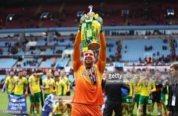 Tim Krul of Norwich City lifts the championship trophy in celebration after the Sky Bet Championship match between Aston Villa and Norwich City at...