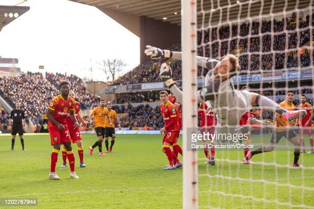 Tim Krul of Norwich City makes a save from a free kick by Ruben Neves of Wolverhampton Wanderers during the Premier League match between...