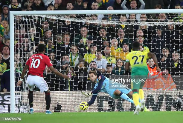 Tim Krul of Norwich City saves a penalty from Marcus Rashford of Manchester United during the Premier League match between Norwich City and...